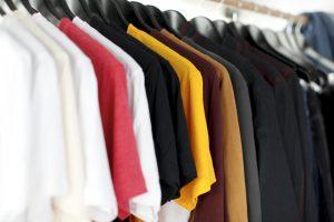 Many t-shirts on a rack